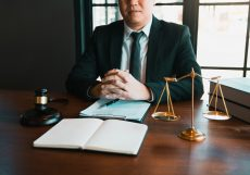 Justice and law concept with male lawyer in the office.