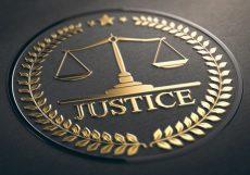 Scales of justice embossed symbol design with golden foil over black paper background. 3D illustration